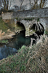 An old bridge over the river Dove in Eye Suffolk England