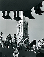HANGING AROUND: Students sitting on the roof of the .Student Union Building listening to speakers at rally in Sproul Plaza at University of California Berkeley. (1967 Photo by Ron Riesterer)