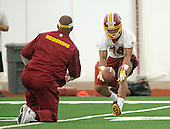 Wide receiver Ryan Grant (14) of Tulane, who was chosen in the fifth round of the recent NFL draft, participates in a drill during the Washington Redskins' rookie minicamp at Redskins Park in Ashburn, Virginia on Saturday, May 17, 2014.<br /> Credit: Ron Sachs / CNP