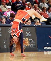 CHARLOTTESVILLE, VA- December 7: A Virginia Cavalier cheerleader vaults across the floor during the game against the Liberty Lady Flames on December 7, 2011 at the John Paul Jones arena in Charlottesville, Va. Virginia defeated Liberty 64-38. (Photo by Andrew Shurtleff/Getty Images) *** Local Caption ***