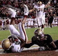 TALLAHASSEE, FL. 11/15/08-FSU-BC CH6-Florida State's Greg Carr, right, lays in the endzone after Boston College's DeLeon Gause from intercepted a pass meant for him in the end zone during fourth quarter action Saturday at Doak Campbell Stadium in Tallahassee.  The Seminoles lost to the Eagles 27-17...COLIN HACKLEY PHOTO