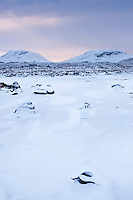 Winter ice of frozen pond on Rannoch Moor, Highlands, Scotland