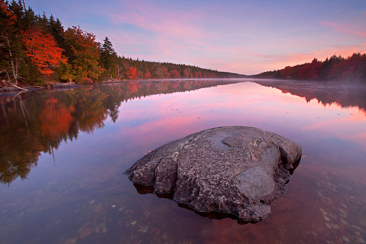 Fall colors surround Long Pond, a one-mile long lake on Isle au Haut near Acadia National Park, Maine