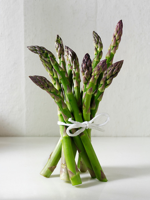 Stock photos of a bunch of fresh English asparagus spears . Funky stock photos images of English Asparagus