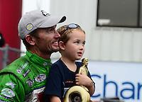 Sept. 30, 2012; Madison, IL, USA: NHRA funny car champion Jack Beckman celebrates with son Jason Beckman after winning the Midwest Nationals at Gateway Motorsports Park. Mandatory Credit: Mark J. Rebilas-