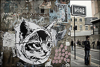 Catface sticker on a Shoreditch wall, East London