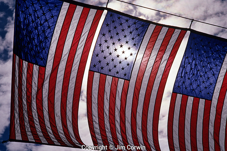 American flag banner backlit hung across main street downtown, Fourth of July celebration, Petaluma, Califronia USA.