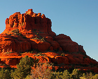 A brilliant red Bell Rock at sunset in Sedona, AZ