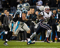 The Carolina Panthers play the New England Patriots at Bank of America Stadium in Charlotte North Carolina on Monday Night Football.  The Panthers defeated the Patriots 24-20.  New England Patriots running back Stevan Ridley (22), Carolina Panthers cornerback Melvin White (23), Carolina Panthers outside linebacker Thomas Davis (58)