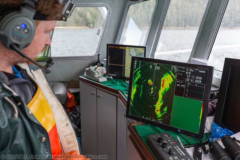 Fisherman reads sonar data during a Herring opener in Salisbury Sound, north of Sitka