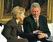 United States President Bill Clinton and first lady Hillary Rodham Clinton share a light moment during the live broadcast of the &quot;Millennium Evening Lecture Series from the East Room of The White House in Washington, DC on 18 September, 1998.<br /> Credit: Ron Sachs / CNP