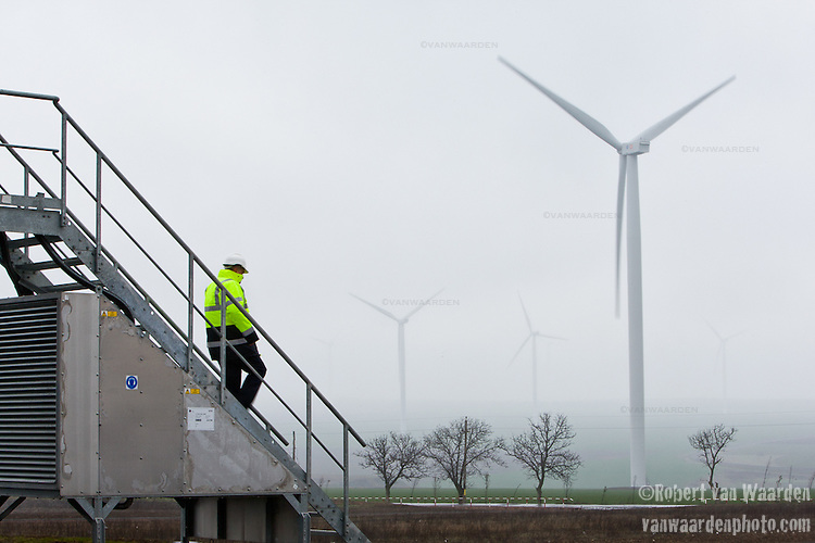 Miklos Szilagyi descends the stairs of a turbine on the Fantanele-Cogealac wind farm in Romania.