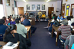 Parents, educators and community members attend a SRC FMP meeting held at the library of Fulton Elementary. (Bas Slabbers/for NewsWorks)