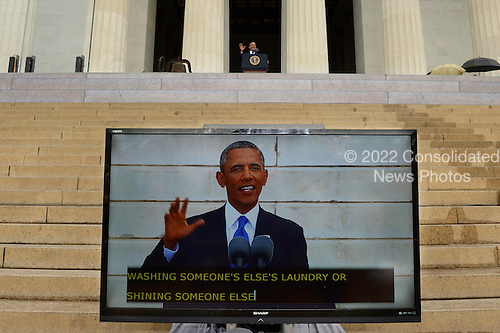 A monitor shows the image of US President Barack Obama (back) delivering remarks during the 'Let Freedom Ring' commemoration event, at the Lincoln Memorial in Washington DC, USA, 28 August 2013. The event was held to commemorate the 50th anniversary of the 28 August 1963 March on Washington led by the late Dr. Martin Luther King Jr., where he famously gave his 'I Have a Dream' speech.<br /> Credit: Michael Reynolds / Pool via CNP