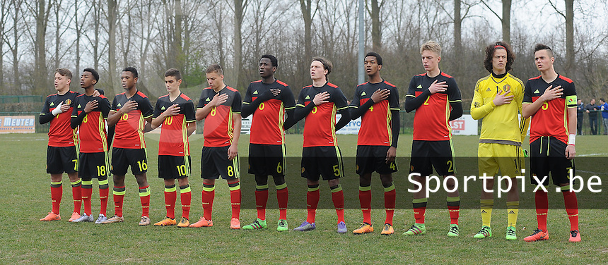 20160316 - Merchtem , BELGIUM : Team of Belgium with Mile Svilar (1)  Sebastiaan Bornauw (2)  Zinho Vanheusden (3)  Hannes Delcroix (4)  Daam Foulon (5)  Daouda Peeters (6)  Thibaud verlinden (7)  Milan Corryn (8)  Francesco Antonucci (10)  Lois Openda (16)  Mike Trésor Ndayishimiye (18)  pictured during the soccer match between the under 17 teams of  Belgium and Spain , on the third and last matchday in group 8 of the UEFA Under17 Elite rounds at FC Merchtem 2000 stadion in Merchtem , Belgium. Wednesday 16 th March 2016 . PHOTO DAVID CATRY