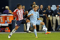 Seth Sinovic (16) Sporting KC holds off Mario de Luna Chivas Gudalajara... Sporting Kansas City and Chivas Guadalajara played to a 2-2 tie in an international friendly at LIVESTRONG Sporting Park, Kansas City, Kansas.