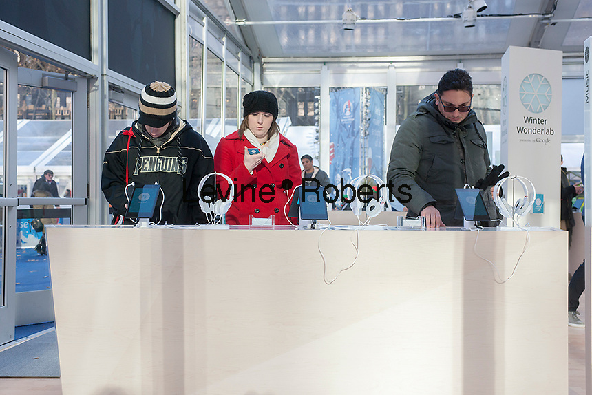 Visitors to Google's Winter Wonderlab pop-up in Bryant Park in New York on Wednesday, December 11, 2013. The minimalist store, one of six Google has set up around the country to hawk its products, concentrates on its Nexus 7, Chromebook, Chromecast and Google Play offerings. (© Richard B. Levine)