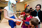 WATERTOWN, CT-28 October 2014-102814EC04--    Emma Karpinski hands out treats to Emma DeFrancisco, 7, and Charlie DeFrancisco, 4, while their mother Gail looks on. Watertown National Honor Society students decorated 13 rooms inside the high school, each with a different theme, and handed out candy to children Tuesday night. Erin Covey Republican-American