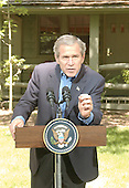 United States President George W. Bush answers reporters questions on the Middle East during a press conference with President Hosni Mubarak of Egypt at Camp David, Maryland  on Saturday, June 8, 2002..Credit: Greg E. Mathieson - Pool via CNP