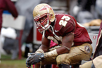 TALLAHASSEE, FL. 10/11/03-A dejected Jerome Carter sets on the bench as the game and the Seminoles chances of beating Miami slip away Saturday at Doak Campbell Stadium in Tallahassee...COLIN HACKLEY PHOTO