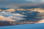 The city of Missoula, Montana and the hills and mountains north of town at sunset in winter