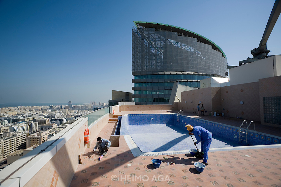 View over downtown Dubai from the rooftop pool of a new building next to BurJuman shopping mall.
