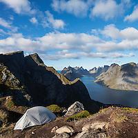 Tent camping on narrow ridge of summit of Reinebringen mountain peak, Reine, Moskenesoy, lofoten Islands, Norway