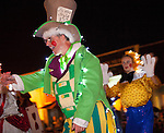 Characters from Alice In Wonderland wave at crowds during the Festival of Lights Parade.