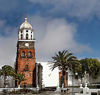 General view of Church of Nuestra Senora de Guadalupe, San Miguel Plaza, Teguise, Lanzarote, Canary Islands, Spain, pictured on November 27, 2010 in the afternoon. Constructed in the first half of the 16th Century the church has a tall bell tower made from volcanic rock and topped by an octagonal belfry. Lanzarote, the Easternmost of the Canary Islands, lies 125km East of the African coast, in the Atlantic Ocean. Like the other islands in this autonomous Spanish archipelago, Lanzarote is originally Volcanic. Picture by Manuel Cohen.