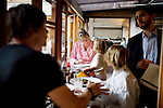 Foreign Cinema chef and owner Gayle Pirie checks in with daughter, Pearl, 3, and son, Magnus, 10, during dinner, as husband, John Clark, left, reviews the wine menu with wine director Zach Pace, in San Francisco, CA., on Friday, June 12, 2009.