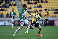 Michael Mcglinchey and Scott Neville in action during the A League - Wellington Phoenix v Newcastle Jets Game at Westpac Stadium, Wellington, New Zealand on Sunday 26 October 2014. <br /> Photo by Masanori Udagawa. <br /> www.photowellington.photoshelter.com.