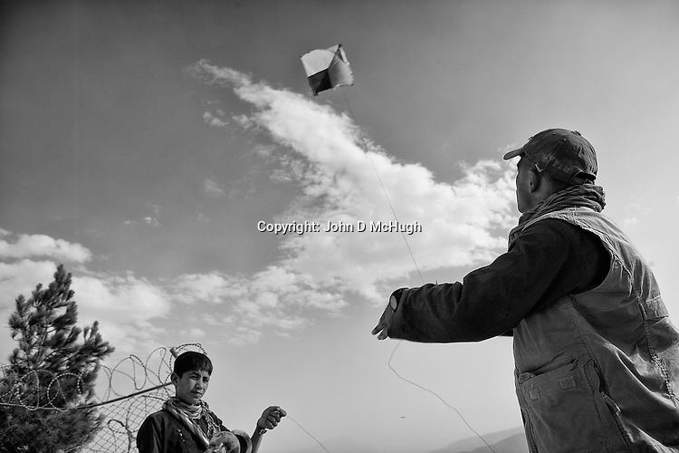 People fly kites at King Zahir Shah's Tomb in Kabul, 24 August 2012. (John D McHugh)