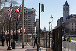 Television trucks and security fences mix with pedestrians near Freedom Plaza on Sunday, January 20, 2013 in Washington, DC.