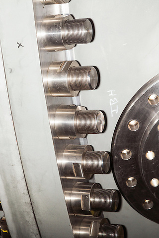 July 6, 2016. Greenville, South Carolina. <br />  The bolts on the casing of a 7HA.02 model GE gas turbine. <br />  At the General Electric Gas Turbine factory, engineers  design, produce, test and repair gas turbines for generating electricity. These turbines weigh more than 900,000 pounds and can create internal combustion temperatures up to 2,900 degrees F. Depending on the model, one of the GE turbines can produce enough electricity for half a million American households.