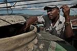 A public servant controlling the water-quality on a rooftop in Santiago De Cuba.