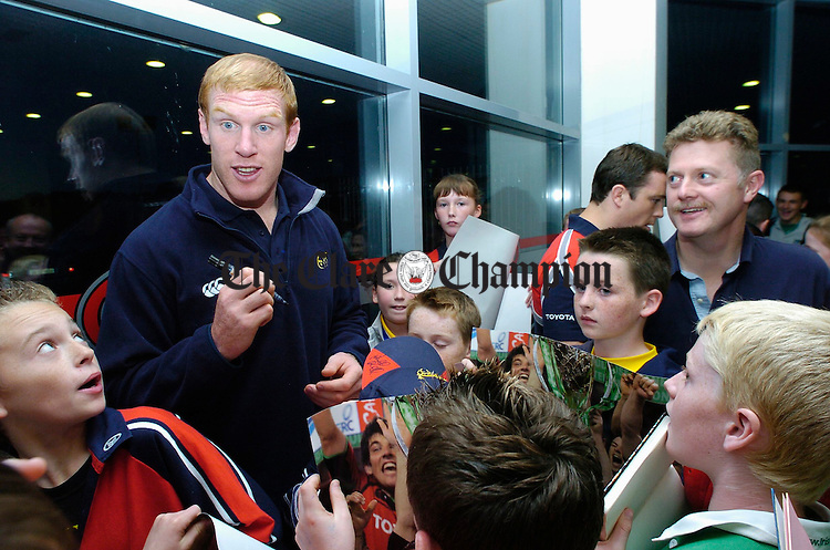 Paul O Connell of Munster rugby signs autographs for fans after his arrival at Tom Hogan Motors'  on the Gort Road in Ennis as part of the team members' visit to the Toyota showrooms with the Heineken cup. Looking on at right is Paul Hogan, proprietor. Photograph by John Kelly.