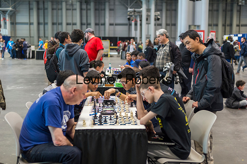 Participants play chess during a break at the FIRST Robotics NYC Championship at the Jacob Javits Convention Center in New York on Sunday, March 13, 2016. The expo enables participants to speak with companies and professional organizations giving a real-world look into science and technology as used in the business world and their career opportunities. (© Richard B. Levine)
