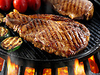 Sirloin beef steaks & tomatoes being pan fried on a bbq. Meat food photos, pictures & images.