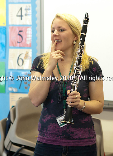 Clarinet lesson taught by two peripatetic teachers, Music class, state primary school.