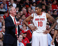 Ohio State Buckeyes head coach Thad Matta talks to Ohio State Buckeyes forward LaQuinton Ross (10) during the second half of the NCAA men's basketball game at Value City Arena on Wednesday, December 18, 2013. Ohio State beat Delaware, 76-64. (Columbus Dispatch photo by Jonathan Quilter)