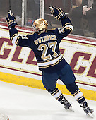 Austin Wuthrich (ND - 27) celebrates. - The visiting University of Notre Dame Fighting Irish defeated the Boston College Eagles 7-2 on Friday, March 14, 2014, in the first game of their Hockey East quarterfinals matchup at Kelley Rink in Conte Forum in Chestnut Hill, Massachusetts.