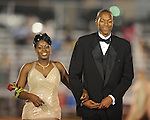 Senior maid J'undra Pegues (left) is escorted by Antonyo Rosser during Lafayette High vs. Byhalia in homecoming football action in Oxford, Miss. on Friday, September 24, 2010.