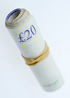 A Roll of Twenty Pound Notes held together with an Elastic Band - Jul 2013.