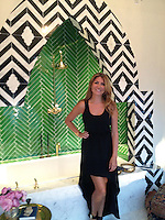 Custom Maharaja, a stone waterjet mosaic shown in polished Nero Marquina and Calacatta Tia, is featured in this bath designed by Genevieve Gorder for Blackman Studio, Southampton NY.