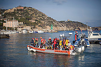 Isola del Giglio, Italy, January 19, 2012. Divers of the firemen squad get ready before searching the cruise liner Costa Concordia aground in front of the harbour of the Isola del Giglio (Giglio island) after hitting underwater rocks.
