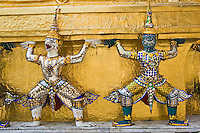 Guardian sculptures at the base of a Golden Chedis, Bangkok, Thailand