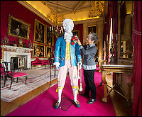 BNPS.co.uk (01202 558833)<br /> Pic: PhilYeomans/BNPS<br /> <br /> Artist Denise Watson puts the finishing flourish to her latest work.<br /> <br /> The notorious husband of the first Lady Diana Spencer has been brought back to life in the glorious surroundings of Blenheim Palace - made entirly of paper.<br /> <br /> Topham Beauclerk, was a 'Macaroni' - an 18th century group of wealthy and fashinable young men so named for their striking and colourful dress.<br /> <br /> He married the original Lady Diana Spencer - Princess Di's namesake and distant cousin - in 1768 after she walked out on her philandering husband.<br /> <br /> A great grandson of Charles II and his mistress Nell Gwynn, he was described as one of the most fashionable men in England and paper costume sculptor Denise Watson of Delicarta has created a stunning representation of his colourful style for a new fashion exhibition at Blenheim Palace.<br /> <br /> Everything from his wig, to his shoes and accessories are made from different types of paper - lighweight but stiffened Mulberry for the wig, painted newsprint paper for the waistcoat and breeches and cardboard tubes for his walking cane.