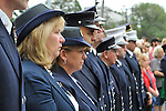 On 10th anniversary of 9/11, Merrick Fire Department ceremony at Merrick Railroad Station, with relatives of those lost during 9/11 attack in NYC, firefighters, Auxiliary members of Merrick Post 1282 of American Legion, with Robbie Rosen singing National Anthem, Brownie Troop 2272 which keeps the Merrick Sta. Memorial Plaza clean, on September 11, 2011, in Merrick, New York, USA.