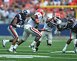 Georgia running back Isaiah Crowell (1) is chased by Ole Miss' Frank Crawford (5) at Vaught-Hemingway Stadium in Oxford, Miss. on Saturday, September 24, 2011. Georgia won 27-13.