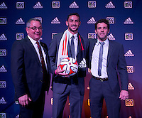 #2 overall pick Steve Birnbaum stands with D.C. United head coach Ben Olsen (right) and general manager Dave Kasper (left) during the MLS SuperDraft at the Pennsylvania Convention Center in Philadelphia, PA, on January 16, 2014.